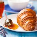 Croissant with lavender honey Royalty Free Stock Photography