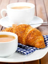 Croissant with marmalade and caffee cup on wooden backgroun Royalty Free Stock Images