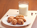 Croissant and milk on wooden table Royalty Free Stock Photography