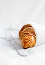 Croissant in muslin fresh french wrapped a white cloth against a light background selective focus copy space Stock Photography