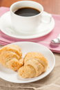 Croissant pastry with coffee cup on table stock image Stock Photography