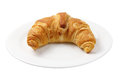 Croissant on plate on white background Royalty Free Stock Photos