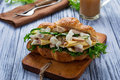 Croissant sandwich with chicken, cheese, cucumber Royalty Free Stock Photo