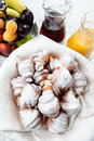 Croissant served breakfast with croissants in powdered sugar jugs of juice and fruit Royalty Free Stock Photography