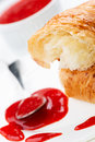 Croissant and strawberry jam in bowl Stock Photo