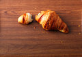 Croissant on wooden table broken Stock Photo