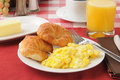 Croissants andd scrambled eggs with and orange juice Royalty Free Stock Photo