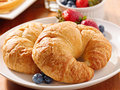 Croissants with berries at breakfast Stock Image