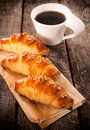 Croissants and coffee homemade stuffed cup of instant selective focus on the front Stock Photography