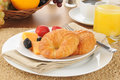 Croissants and fresh fruit baked with cantaloupe blackberries strawberries Stock Photography
