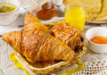 Croissants pastry for breakfast with tea and orange juice Royalty Free Stock Photo