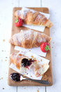 Croissants & strawberries Stock Photos