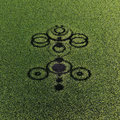 Crop circles on green grass Royalty Free Stock Photo