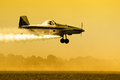 Crop duster silhouette aircraft over field Royalty Free Stock Photo