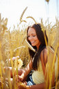 Crop field - Sweet young female with flower Stock Photography