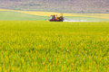 Crop sprayer in a field tractor sprays of crops east sussex england uk Royalty Free Stock Photo