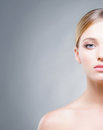 Cropped face of a beautiful woman with blue eyes skin care concept Stock Image