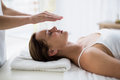 Cropped hands of therapist performing reiki on woman Royalty Free Stock Photo