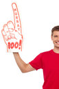 Cropped image of a casual guy with big foam hand Royalty Free Stock Images