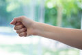 Cropped image of hand clenching fist Royalty Free Stock Photo