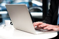 Cropped image of man working on laptop corporate male typing business report Royalty Free Stock Photos