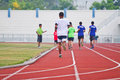 Cropped image of runner on competitive running at thailand Stock Images