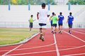 Cropped image of runner on competitive running at thailand Royalty Free Stock Photography