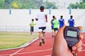 Cropped image of runner on competitive running Royalty Free Stock Photo