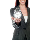 Cropped image of a woman holding alarm clock Stock Photography
