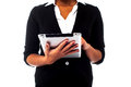 Cropped image of a woman holding touch pad working on tablet pc Stock Photo