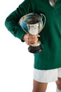 Cropped image of woman with rugby ball and trophy Royalty Free Stock Photo
