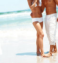 Cropped photo of a couple standing on the beach Stock Images