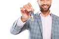 Cropped photo of smiling young man holding keys. Royalty Free Stock Photo