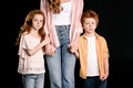 Cropped shot of mother with adorable redhead children standing together and holding hands Royalty Free Stock Photo