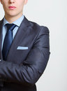 Cropped view portrait partial torso elegant young business man suit tie handkerchief his breast pocket Royalty Free Stock Photos