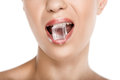 Cropped view of seductive woman holding ice cube in mouth, Royalty Free Stock Photo