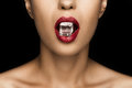 Cropped view of seductive woman with red lips holding ice cube in mouth Royalty Free Stock Photo