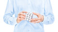 Cropped view torso hands man holding blank white cubic twist puzzle game which trying to solve isolated white Royalty Free Stock Image