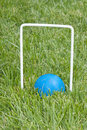 Croquet ball sitting under a hoop Stock Photo