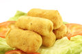 Croquettes plate of potato over lettuce and tomatoes Stock Photography