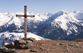 Cross in Alps Stock Photography