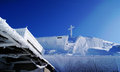 Cross atop mountain snow covered untersberg near salzburg austria Royalty Free Stock Image