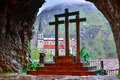 Cross and Basilica de Covadonga, from inside the holy cave Royalty Free Stock Photo