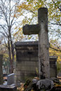Cross at the cemetery in autumn season Stock Photography
