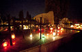 Cross in the cemetery and candles all souls day Stock Photography