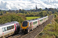Cross country expresses kings sutton uk october two passenger trains pass just north of banbury on october in kings sutton Royalty Free Stock Images