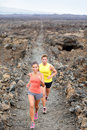 Cross country running woman and man trail runners Stock Photo