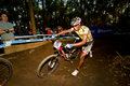 Cross Country XCO Elite Man running through berm Royalty Free Stock Photos