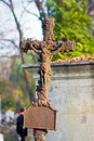 Cross with crucified jesus christ at cemetery Stock Images