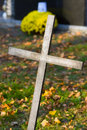 Cross with crucified jesus christ at cemetery Royalty Free Stock Image